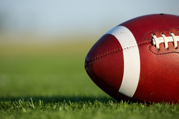 bigstock-American-Football-on-the-Field-36441772-583x388