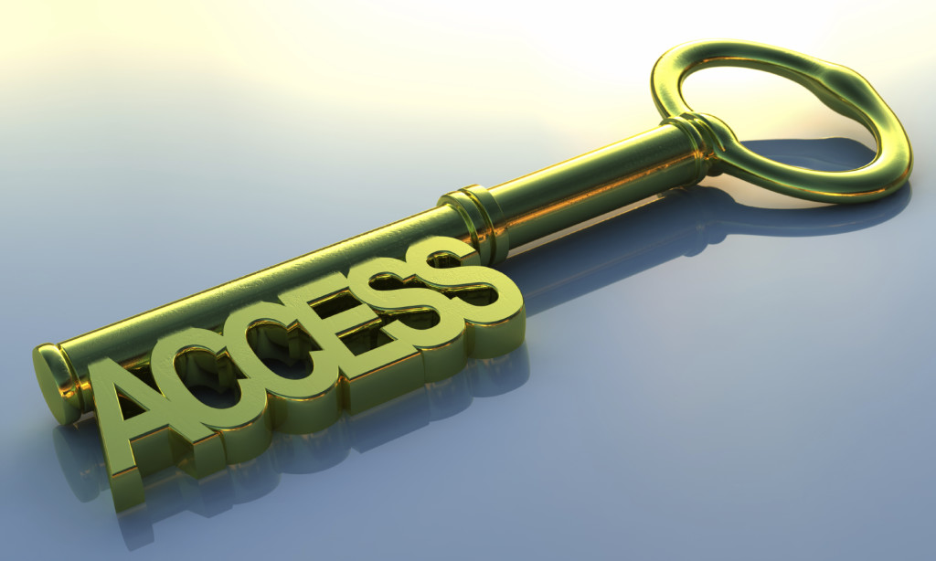 A golden access key. 3D rendering with raytraced textures and HDRI lighting.
