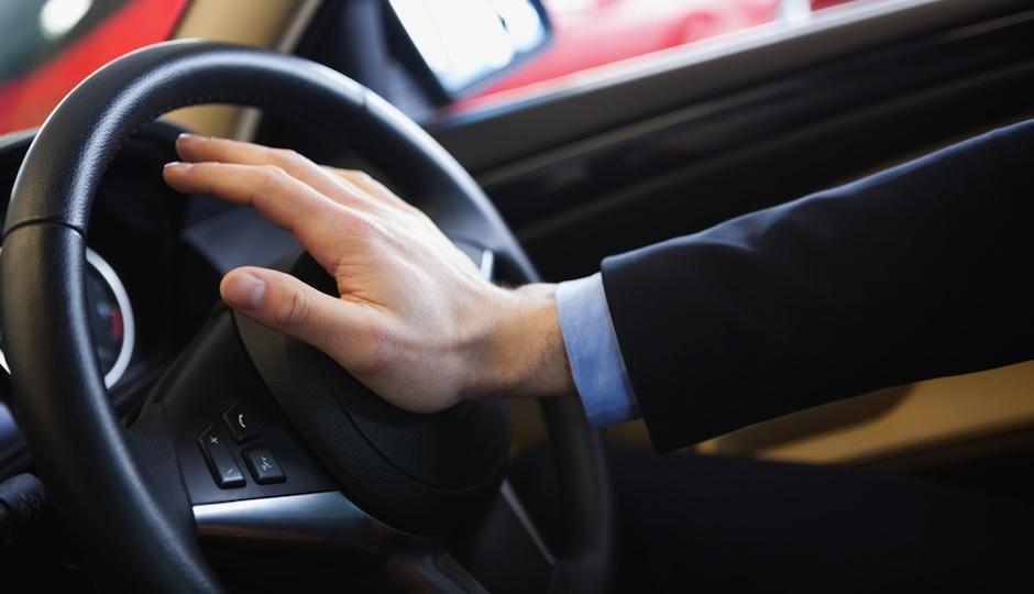 pw-man-honking-car-horn